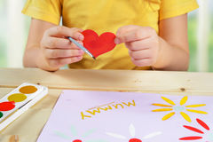 Child makes a greeting card Royalty Free Stock Images