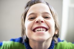 Child makes grimaces Royalty Free Stock Images