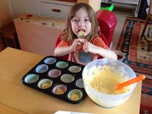 Child making cakes. Royalty Free Stock Image