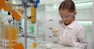 Child Making Chemical Experiment in School Lab, Student Girl in Science Class 4K.  stock video footage