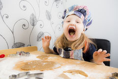 Child making Christmas cookies Royalty Free Stock Photo