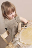 Child making Christmas cookies. Pre school child with dough and christmas cookie cutters Stock Photos