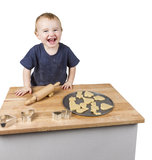 Child making cookies Royalty Free Stock Photos