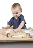 Child making cookies Stock Photography