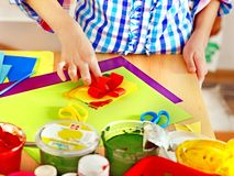 Child making decoration card.. Royalty Free Stock Photos