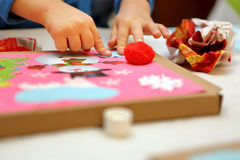Child making decoration for Christmas Royalty Free Stock Images