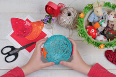 Child making Easter eggs. Kids Art, Art Projects, Handmade Easter decorations Stock Photo