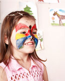 Child making face painting. royalty free stock photo