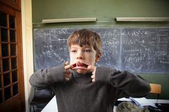 Child making faces Royalty Free Stock Photo