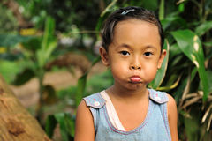 Child Making Faces Stock Images