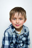 Child making funny faces. Portrait of a boy a having fun, making faces and funny expressions Royalty Free Stock Images