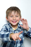 Child making funny faces. Portrait of a boy having fun, making faces and funny expressions Stock Image