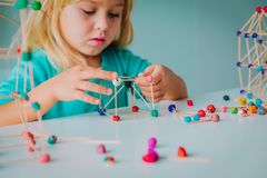 Child making geometric shapes, engineering and STEM. Learning stock photography