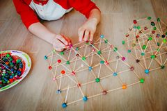 Child making geometric shapes, engineering and STEM education. Learning stock images