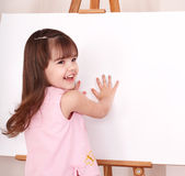 Child  making hand prints. Royalty Free Stock Image
