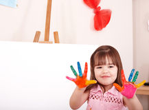 Child making hand prints. Little girl making hand prints royalty free stock image