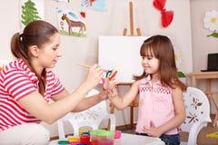 Child making handprints. royalty free stock photography