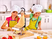 Child making homemade pasta. Royalty Free Stock Images
