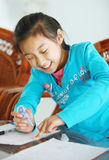 Child making homework Stock Image