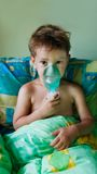 Child making inhalation Royalty Free Stock Images