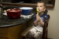 Child making a mess baking with mom Stock Photos