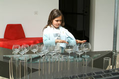Child making music with glasses Royalty Free Stock Photography