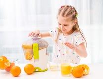 Child making orange juice royalty free stock photos
