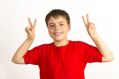 Child Making Peace Sign Stock Image