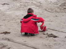 Child making sand castles. A young boy making sand castles on a scottish beach Royalty Free Stock Photo