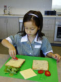 Child Making A Sandwich. Stock Photo