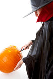 Child is making scary face out of pumpkin Stock Photo
