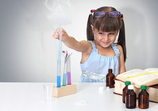 Child making sciencel test Stock Images