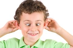 Child making silly faces. 8 year old boy making silly faces Stock Photography