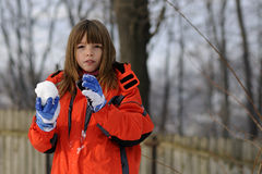 Child making snowballs Stock Image
