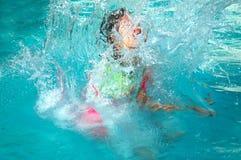Child making a splash Royalty Free Stock Images
