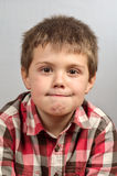 Child making ugly faces 3 Royalty Free Stock Images