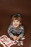 Child making Valentine's Day Craft with Hearts Stock Image