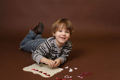 Child making Valentine's Day Craft with Hearts Stock Images