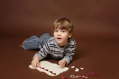 Child making Valentine's Day Craft with Hearts Royalty Free Stock Photo