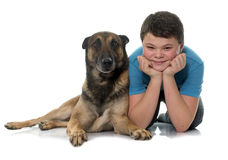 Child and malinois. In front of white background Stock Image