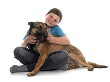 Child and malinois. In front of white background Royalty Free Stock Photo