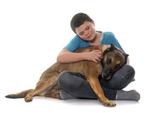 Child and malinois. In front of white background Royalty Free Stock Photos