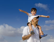 Child on man shoulders Stock Photography