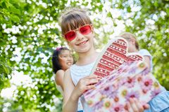 Child with many birthday gifts. In party at park royalty free stock photos