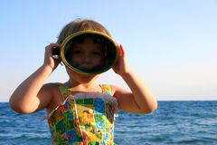 Child in mask. The child in a mask for diving, on a background of the sea Royalty Free Stock Photography