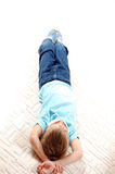 Child with mask on the floor Royalty Free Stock Photo
