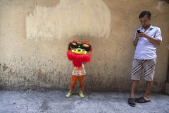 Child with mask used for the Lion dance. Lion dance is a form of traditional dance in Chinese culture and other Asian countries in which performers mimic a lion` Royalty Free Stock Photo