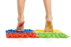 Child on massage mat. Doing exercises for flatfoot prevention royalty free stock photography