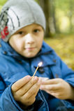 Child with a match Royalty Free Stock Photos