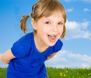 Child on the meadow Stock Photos